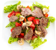 Vegetable salad with mashrooms and meat isolated. On white background Stock Photography