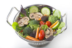 Vegetable salad. With metal colander in sink Stock Photo