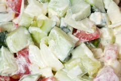 Vegetable salad with onion, tomato and cucumber as a background Royalty Free Stock Photography