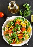 Vegetable salad with pieces of chicken meat. On dark stone background. Top view Royalty Free Stock Photography