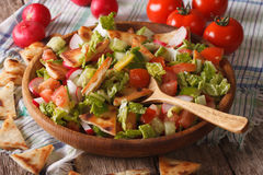 Vegetable salad with pita close up in a wooden bowl Stock Photos