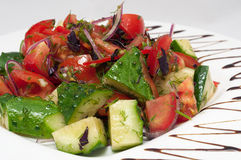 Vegetable salad in plate decorated with balsamic sauce Stock Photography