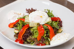 Vegetable salad. With poached egg Stock Photos