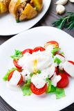 Vegetable salad with poached egg Royalty Free Stock Photos