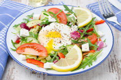 Vegetable salad with poached egg on a plate, horizontal Royalty Free Stock Photo