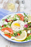 Vegetable salad with poached egg, vertical Royalty Free Stock Image