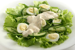 Vegetable salad with quail eggs. And onions stock images