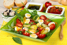 Vegetable salad with quail eggs Stock Photo