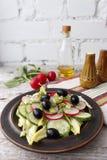 Vegetable salad with radish. Vegetarian salad of cucumbers and radish Royalty Free Stock Photo