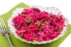 Vegetable salad with raw beets, carrots and cabbage. Studio Photo Stock Photography