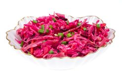 Vegetable salad with raw beets, carrots and cabbage. Studio Photo Stock Images