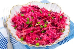 Vegetable salad with raw beets, carrots and cabbage. Studio Photo Stock Image