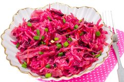 Vegetable salad with raw beets, carrots and cabbage. Studio Photo Stock Photo