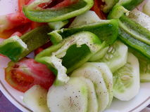 Vegetable salad. Raw vegetables in a salad with black pepper Stock Images