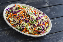 Vegetable salad with red cabbage, carrots, sweet peppers, herbs and seeds. Royalty Free Stock Photography