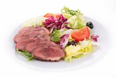 Vegetable salad and red meat Royalty Free Stock Image