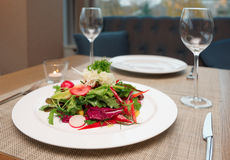 Vegetable salad on restaurant table Royalty Free Stock Photo