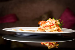 Vegetable salad with sauce. On black background stock photography