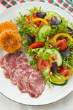 Vegetable salad, sausage and cheese toasts Royalty Free Stock Photos