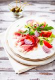 Vegetable salad with serrano ham on a plate stock photos