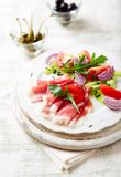 Vegetable salad with serrano ham on a plate stock images