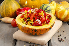 Vegetable salad served in pumpkin Royalty Free Stock Image