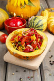 Vegetable salad served in pumpkin Royalty Free Stock Photography