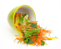 Vegetable salad in spilling out the tableware Stock Photo