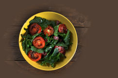 Vegetable salad with tomatoes and arugula Royalty Free Stock Image