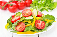 Vegetable salad with tomatoes, cucumbers, bell peppers and rucol Royalty Free Stock Photo