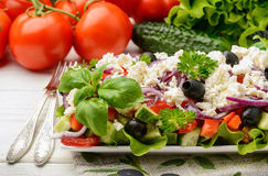 Vegetable salad with tomatoes, cucumbers, olives and feta cheese -bulgarian traditional summer salad. Stock Photos