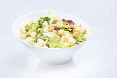 Vegetable salad with tomatoes and lettuce on white Stock Photography