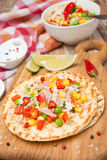 Vegetable salad with tuna on wheat tortillas Royalty Free Stock Images