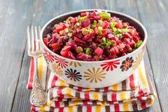 Vegetable salad vinaigrette of beets, pickles, sauerkraut, potatoes, green peas and lentils. Stock Photo