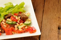 Vegetable salad with white beans, rye toasts, tomatoes, cucumber Stock Photos