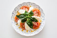 Vegetable Salad on White and Blue Round Floral Plate Stock Image