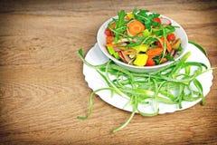 Vegetable salad in white bowl Stock Image