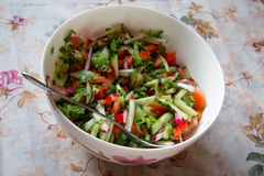 Vegetable salad in white bowl. Vegetable salad with tomatoes, cucumbers, sweet peppers and lettuce Stock Photo