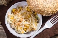 Vegetable salad and white bun Stock Photo