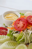 Vegetable salad on white plate. Stock Photo