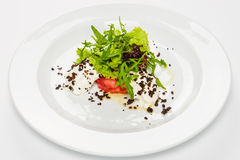 Vegetable salad with white sauce and grilled crumbs on plate. Stock Photo