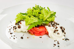 Vegetable salad with white sauce and grilled crumbs on plate. Stock Photography