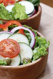 Vegetable salad in a wooden bowl. Royalty Free Stock Image