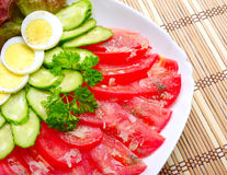 Vegetable salad on wooden mat Royalty Free Stock Photo