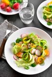 Vegetable salad from zucchini, radish, greens. Natural organic food. Vegetable salad from zucchini, radish, greens. Top view Royalty Free Stock Image