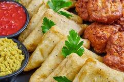 Vegetable samosas and onion bhajis Royalty Free Stock Images