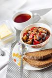 Vegetable sauté with eggplant, red pepper and tomatoes, and toasted rye bread. On a plate royalty free stock photos