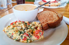Vegetable Scramble with Grits and Toast. On table Stock Photos