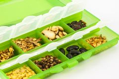 Vegetable Seeds. Many kind of vegetable seeds in a green  cartridge Stock Photography