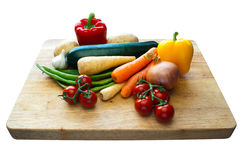 Vegetable Selection on Wooden Board. Vegetable selection on a wooden chopping board with an isolated background Royalty Free Stock Photo